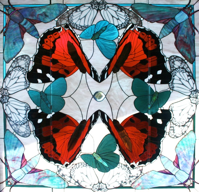NATIVE JEWELS OF HAWAII, by Calley O'Neill, Designer/Artist and Lamar Yoakum, Master Stained Glass Artisan, Big Island Hawaii.  This window is part of a collection of pieces at The Malamapono Center in Waimea, Hawaii.