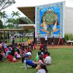 Kipapa students enjoy their new mural. Most joyful for them is that they helped to build it, using over 15,000 pieces of smalti to create the border.