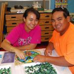 Parents of the models, Jayna and William Elisaga work together on the project.