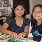 Art Advisory Student Jessica Reyes and her mom, Josie work together.