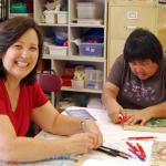 Susan Kam thought of the mural idea, and she and Joy Nishimura both worked to bring the mural to the school.